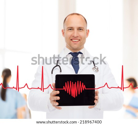 medicine, profession, teamwork and healthcare concept - smiling male doctor with stethoscope showing tablet pc computer screen over blue background - stock photo
