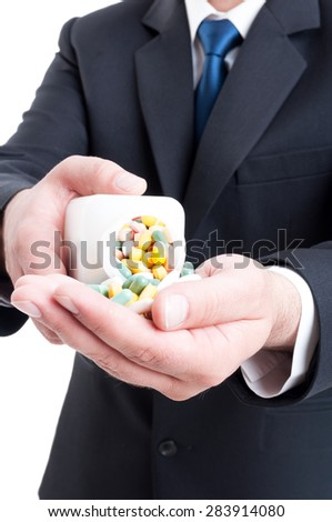 Medicine sales man rep offering pills by puring them in hand - stock photo
