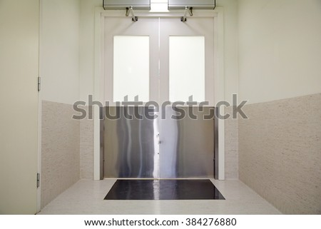 medicine, science, health care, emergency and interior concept - doors at hospital or laboratory corridor - stock photo