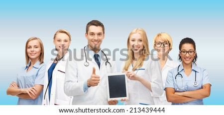 medicine, technology and healthcare concept - team or group of doctors and nurses with tablet pc computer blank screen showing thumbs up - stock photo