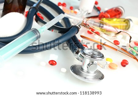 medicines and a stethoscope on a blue background close-up