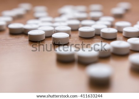 Medicines on wood background selective focus