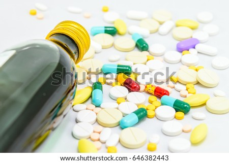 Medicines. Pills and capsules on white background