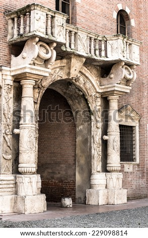 Medieval arch with a balcony in the historic centre of Verona.Italiy