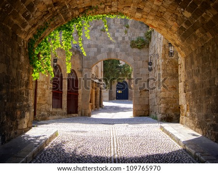 Medieval arched street in the old town of Rhodes, Greece - stock photo