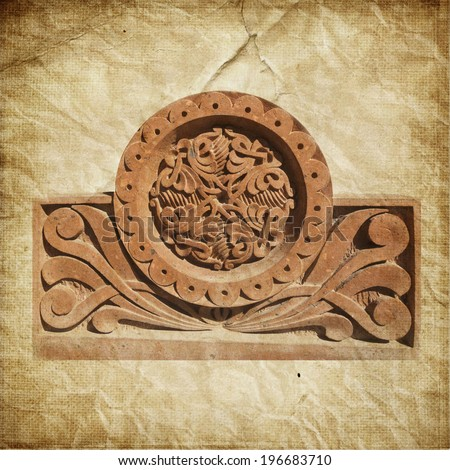 Medieval Armenian ornament on cross stone over paper background - stock photo