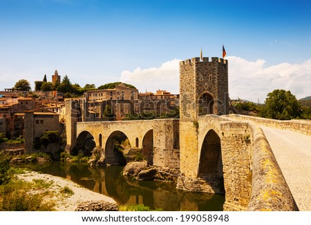 Medieval bridge with city gate, built in the 12th century. Besalu, Catalonia - stock photo