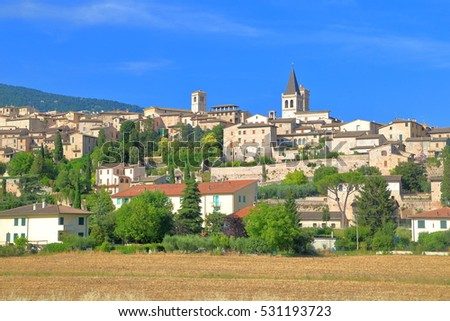 Medieval buildings and old church in Spello, region of Umbria, Italy