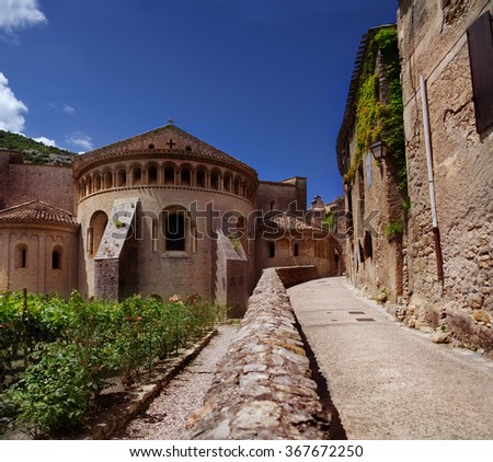 Medieval buildings of the Abbey of Saint-Guilhem-le-Desert in a small  town in the south of France. It's classed as a French Historical Monument. - stock photo