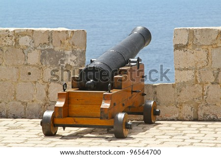 Medieval cannon at fortress wall
