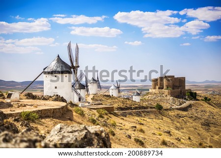 Medieval castle and windmills of Consuegra in Toledo province, Castilla La Mancha, central Spain.  - stock photo