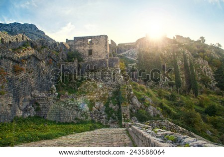 medieval castle in Kotor mountains during sunset, Montenegro - stock photo