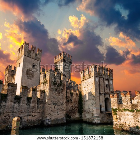 Medieval Castle Scaliger at sunset - stock photo
