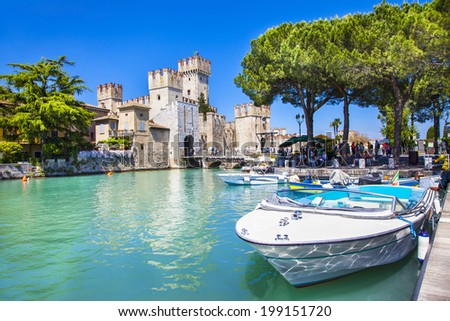 medieval castle Scaliger in old town Sirmione on lake Lago di Garda - stock photo