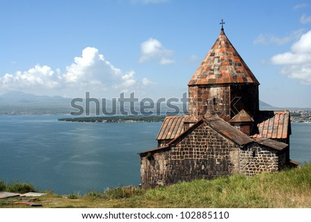 Medieval church on Sevan lake, Armenia - stock photo