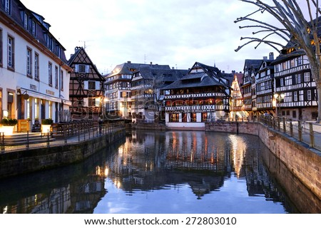 Medieval cityscape of Rhineland black and white timber-framed buildings in the Petite-France district alongside the river Ill at twilight - France, Alsace region, Strasbourg - stock photo