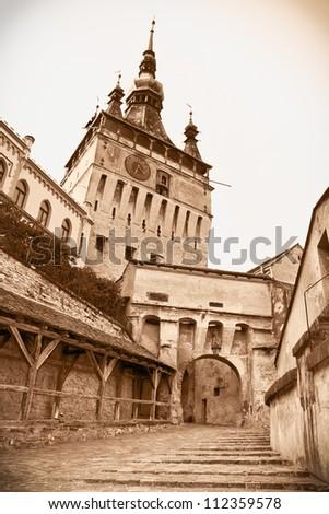 Medieval clock tower at  Sighisoara Citadel in Sighisoara,  saxon landmark of Transylvania, Romania - stock photo