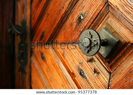 medieval door handle to lock in the background