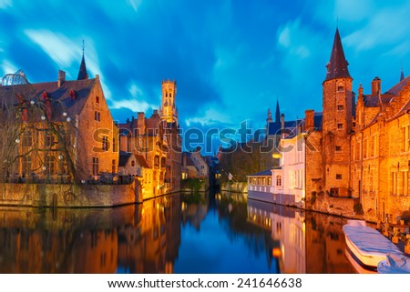 Medieval fairytale town and tower Belfort from the quay Rosary, Rozenhoedkaai, at sunset in Bruges, Belgium