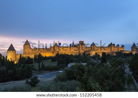 Medieval fortress and walled city of Carcassonne in the Languedoc-Roussillon region of France. Founded by the Visigoths in the 5th century, it was restored in 1853. Now a UNESCO World Heritage Site. - stock photo