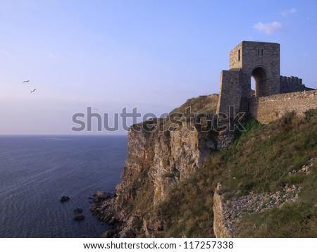 Medieval fortress on Cape Kaliakra, Black Sea, Bulgaria Kaliakra is a long and narrow headland in the Southern Dobruja region of the northern Bulgarian Black Sea Coast, located 12 km east of Kavarna. - stock photo