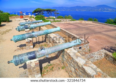 Medieval fortress with aged canons pointing to the sea in Saint Tropez, French Riviera, France - stock photo