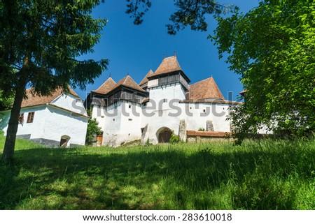 Medieval Gothic church in Viscri  - stock photo