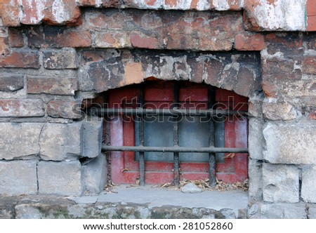 Medieval grilled basement window of the old house in Russia - stock photo
