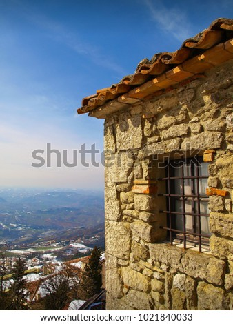 Medieval house with window with beautiful landscape background in San Marino