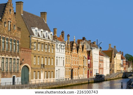 Medieval houses besides a canal in Bruges, Belgium