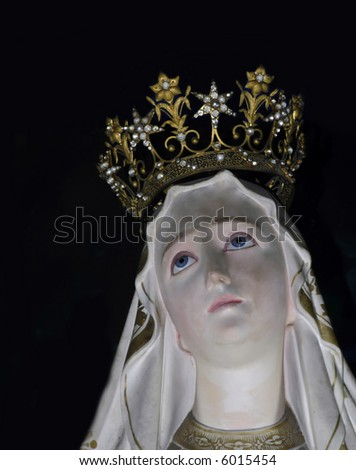 Medieval iconic statue of the Holy Virgin Mary in one of Malta's churches. - stock photo