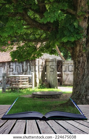 Medieval ironmonger shed in forest landscape setting conceptual book image