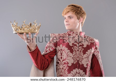 Medieval King. Medieval king with sword and crown.  - stock photo
