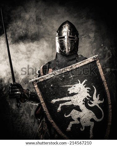 Medieval knight against stone wall - stock photo