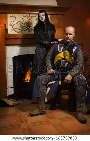 Medieval knight and death in a castle - stock photo