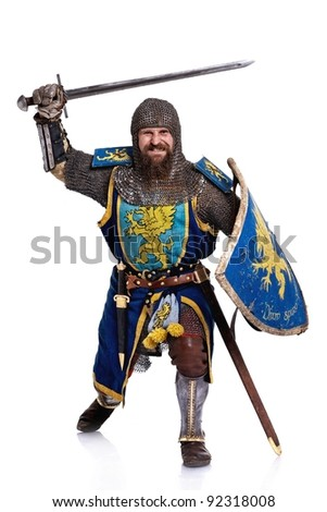 Medieval knight in attack position. - stock photo