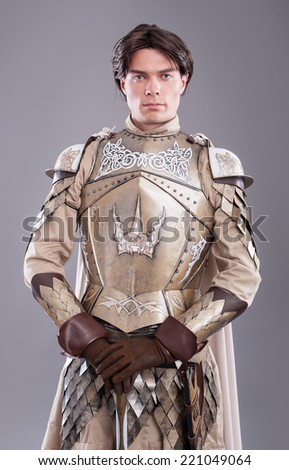 Medieval Knight. Medieval knight in armor with a sword - stock photo