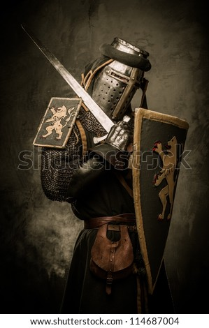 Medieval knight with a sword - stock photo