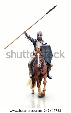Medieval knight with the lance riding the horse. Focus point on the knight.