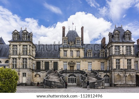 Medieval landmark - royal hunting castle Fontainbleau. Palace of Fontainebleau - one of largest royal chateaux in France (55 km from Paris), UNESCO World Heritage Site.