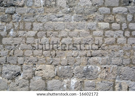 Medieval limestone wall - stock photo