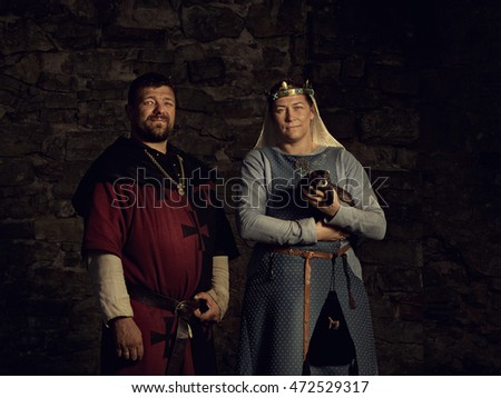 Medieval lovers. Fairy couple with a weasel in  costumes