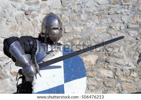 medieval metal armor and helmet mercenary knight swordsman