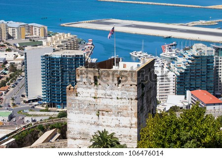 Medieval Moorish Tower of Homage, apartment houses and airport runway in Gibraltar. - stock photo