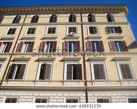 Medieval Old Ancient Style Architecture Facade Of Traditional European Italian Apartment Building In Rome Downtown Urban