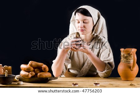 medieval or Fantasy tavern serving girl - stock photo