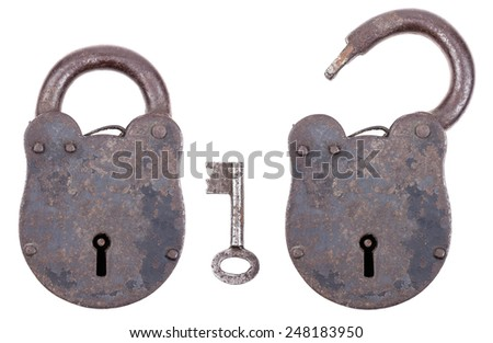 Medieval padlock with key, made of iron and slightly rusty. Portable lock with a shackle that may be passed through an opening to protect against unauthorized use, theft, vandalism or harm. - stock photo