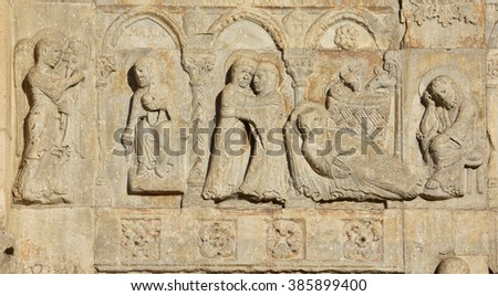 Medieval relief of conception and birth of Jesus, with Virgin Mary, Saint Joseph and Archangel Gabriel from Basilica of San Zeno facade, in Verona (12th century) - stock photo