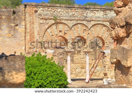 Medieval ruins and beautiful Moorish arches of the House of Jafar in Medina Azahara, Cordoba, Andalusia, Spain