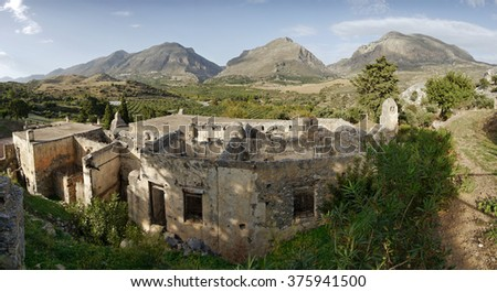 Medieval ruins and mountains in the background
